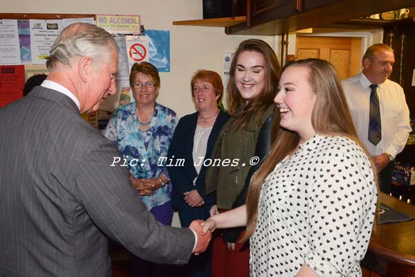 HRH The Prince of Wales meeting family and friends of the landlady at The New Inn