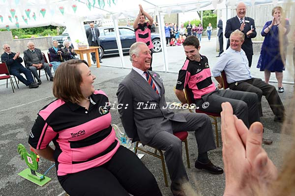 HRH The Prince of Wales competing with members of Llanddewi Brefi Young Farmers Club in a Cockerel race in the marquee at The New Inn