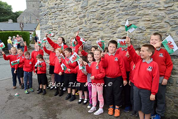 Pupils from the Llanddewi Brefi Campus of Ysgol Henry Richard waving farewell to HRH The Prince of Wales outside The New Inn