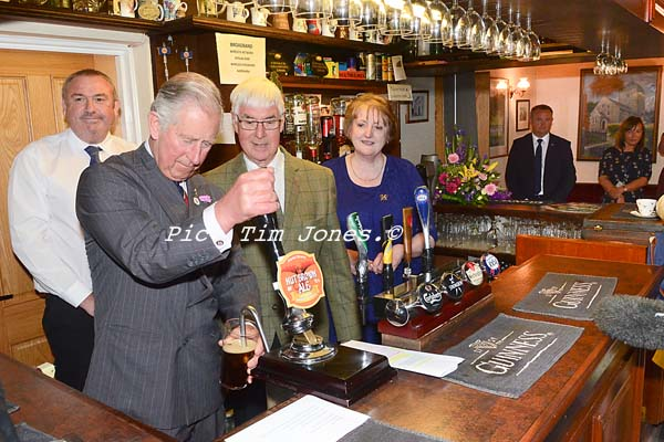 HRH The Prince of Wales behind the bar at The New Inn, Llanddewi Brefi
